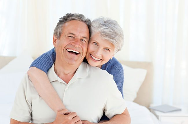 Older couple with attractive smiles