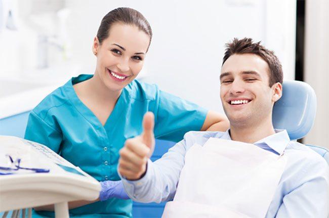 Dentist with happy man